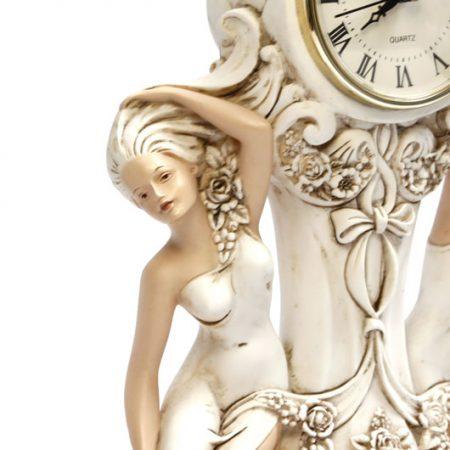 close up of ornamental lady clock