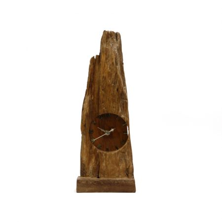 driftwood clock with face carved into it