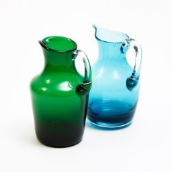 green and blue blown glass jugs