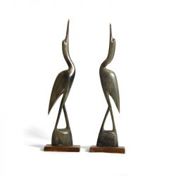 a pair of cranes made from animal horn