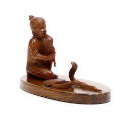 wood snake charmer ornament
